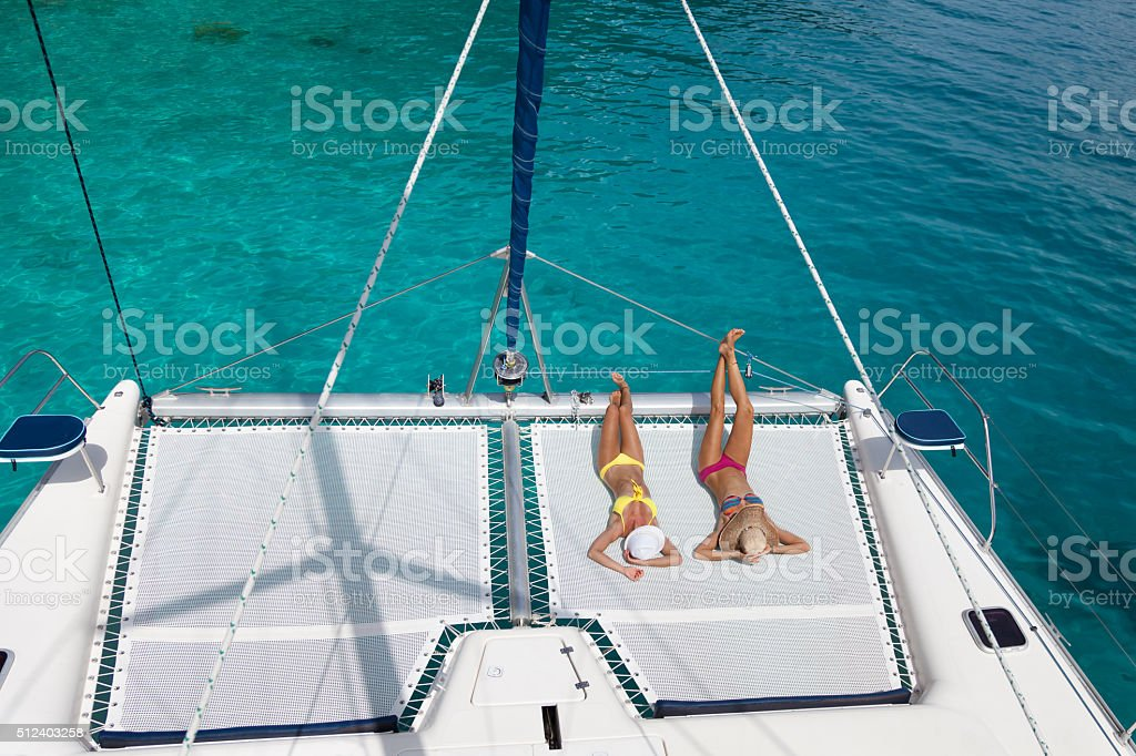 Women relaxing on catamaran in the Caribbean stock photo