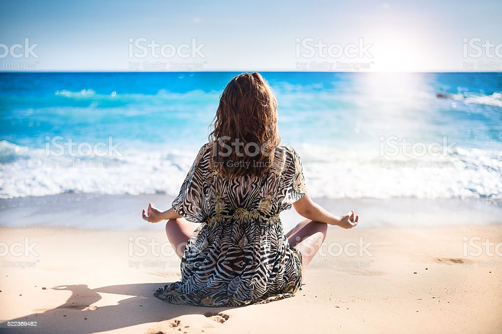 Women relaxing on the beach stock photo