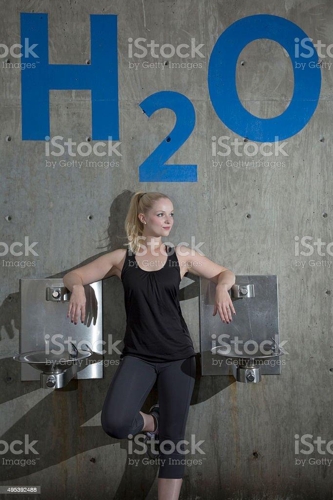 Women resting bt water fountain stock photo