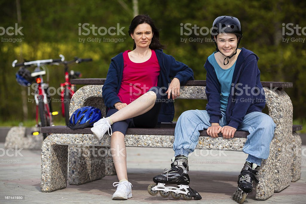 Women resting outdoor after exercising royalty-free stock photo