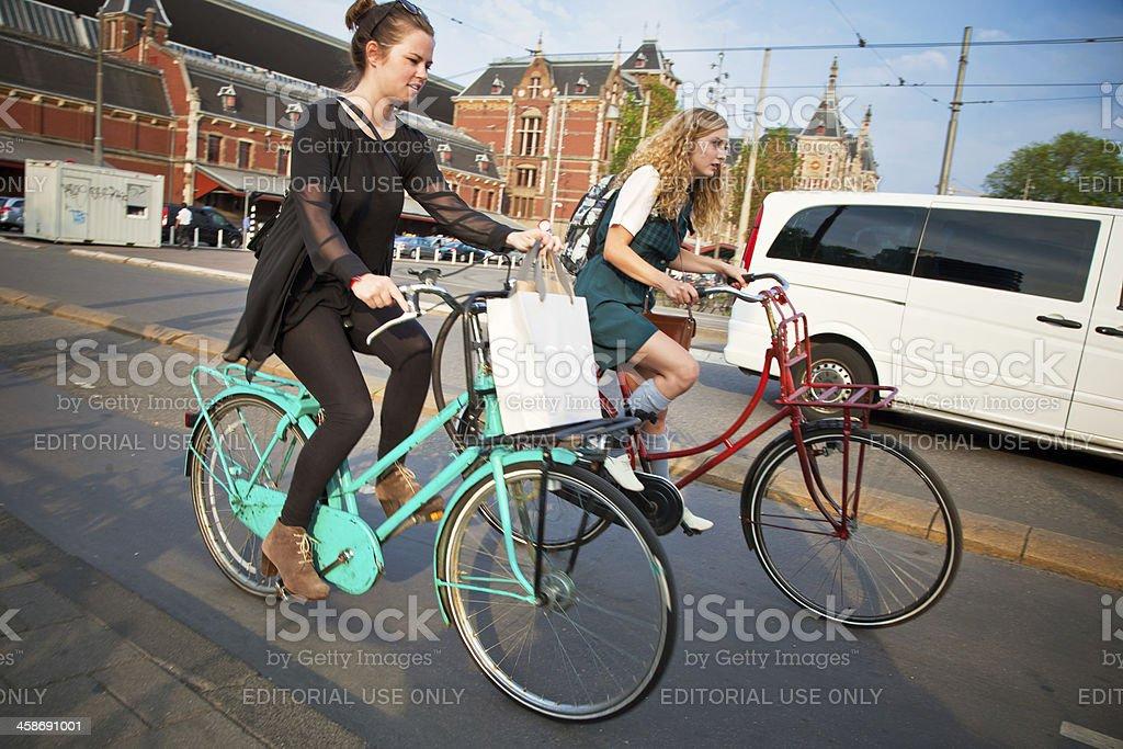 women riding bikes in Amsterdam royalty-free stock photo