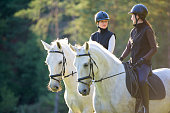 Women riding horses