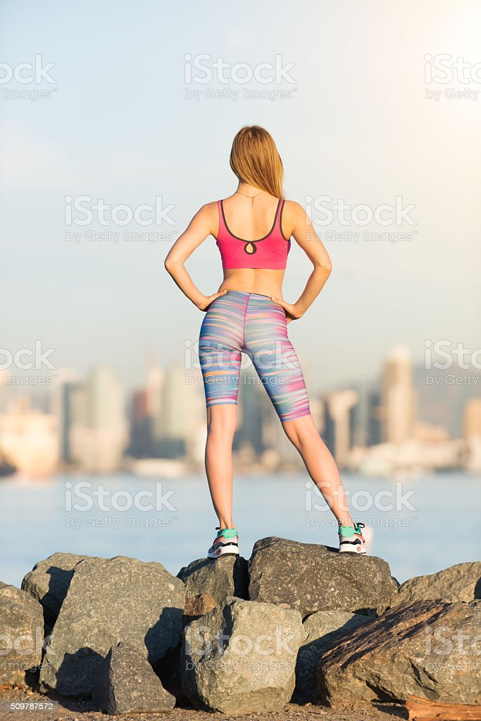 Women Runner Stopping and Looking At the City stock photo