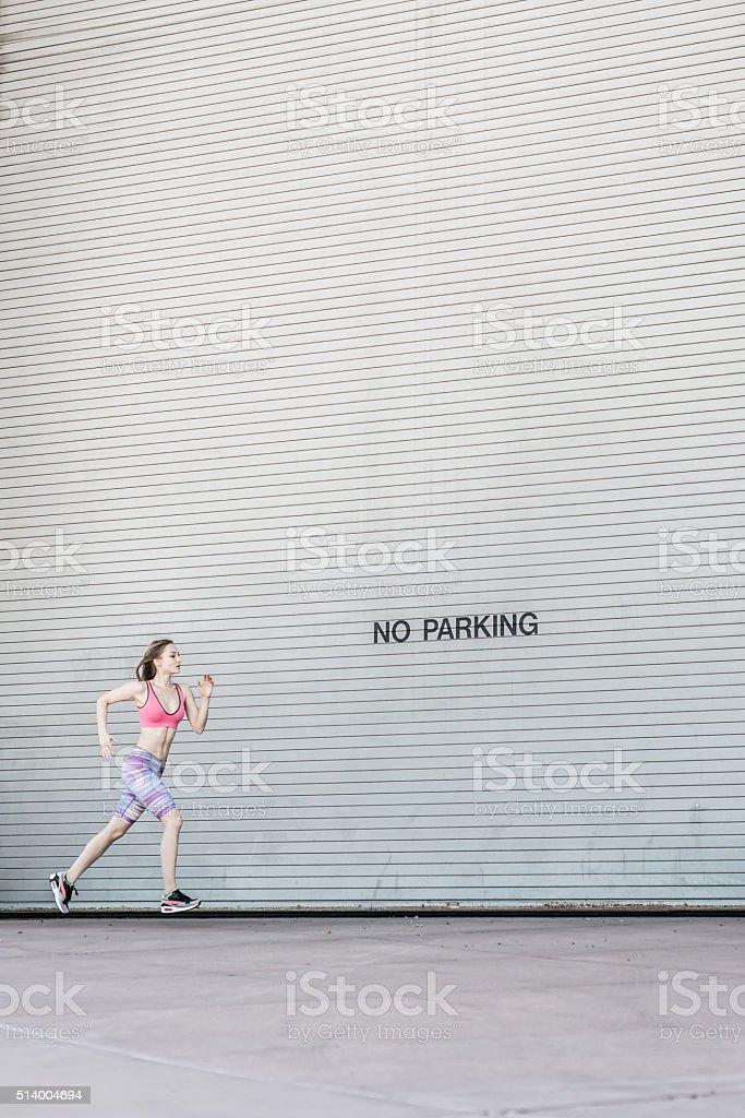 Women Running Across A No Parking Zone stock photo