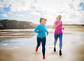 Women Running along a Beach Together
