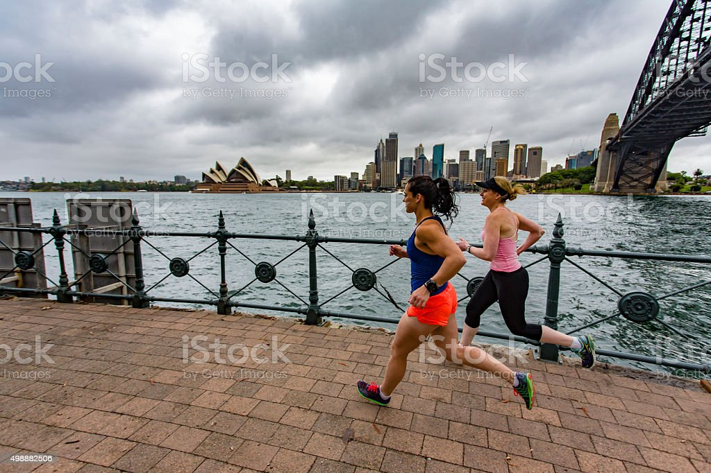 Women Running by Sydney Harbour stock photo