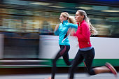 Women running in the city streats