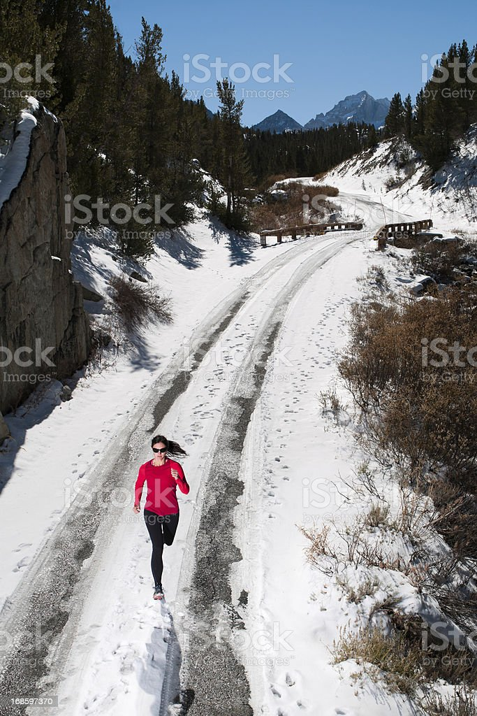 Women Running in the Snow royalty-free stock photo