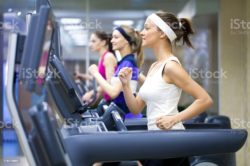 Women running in the treadmills in the gym stock photo