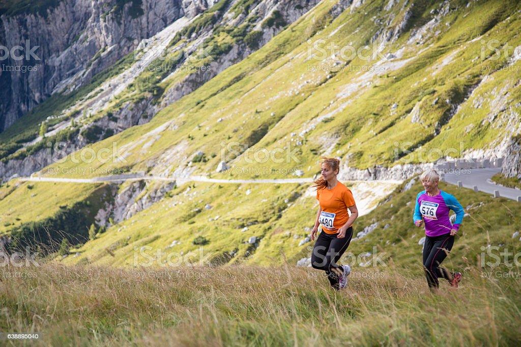 Women running on hill stock photo
