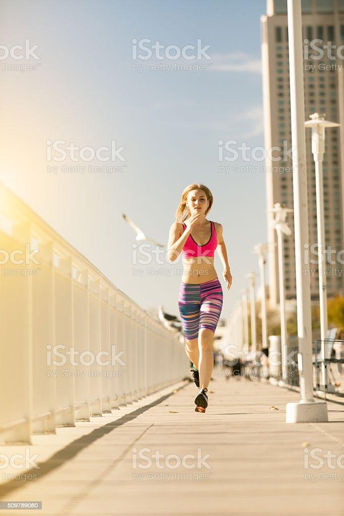 Women Running The San Diego Bay City Skyline stock photo