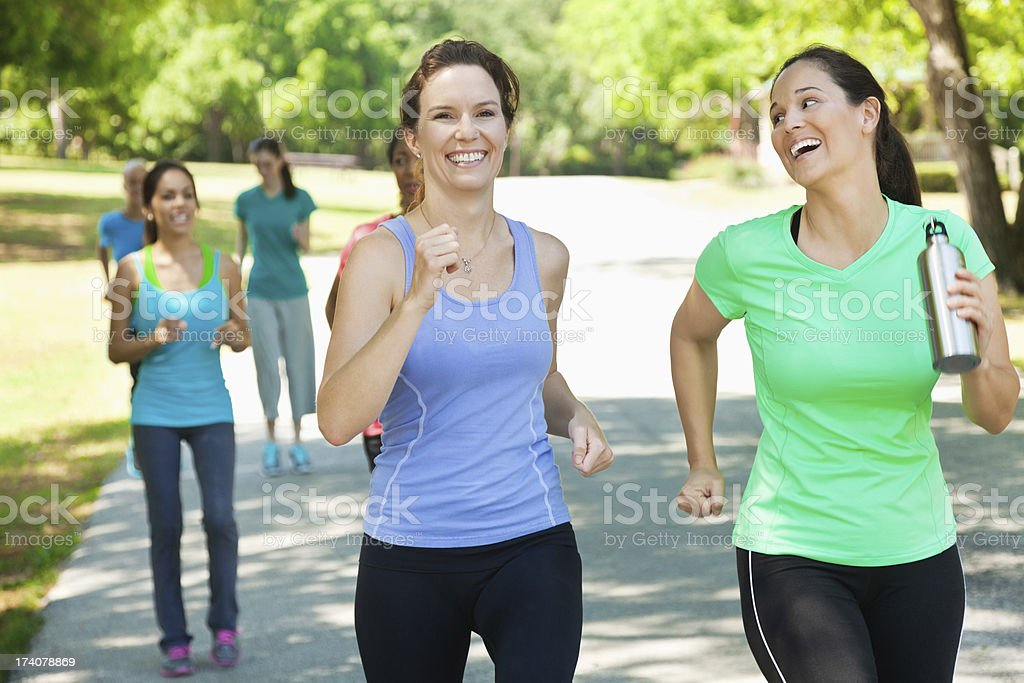 Women running with fitness group in outdoor class royalty-free stock photo