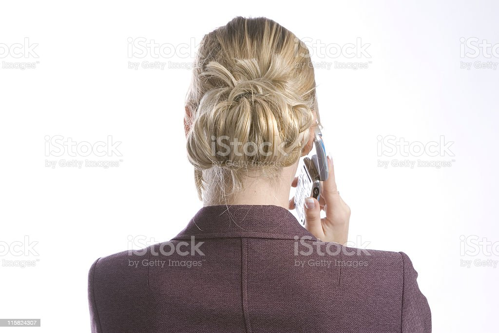 women seen from behind making phonecall royalty-free stock photo