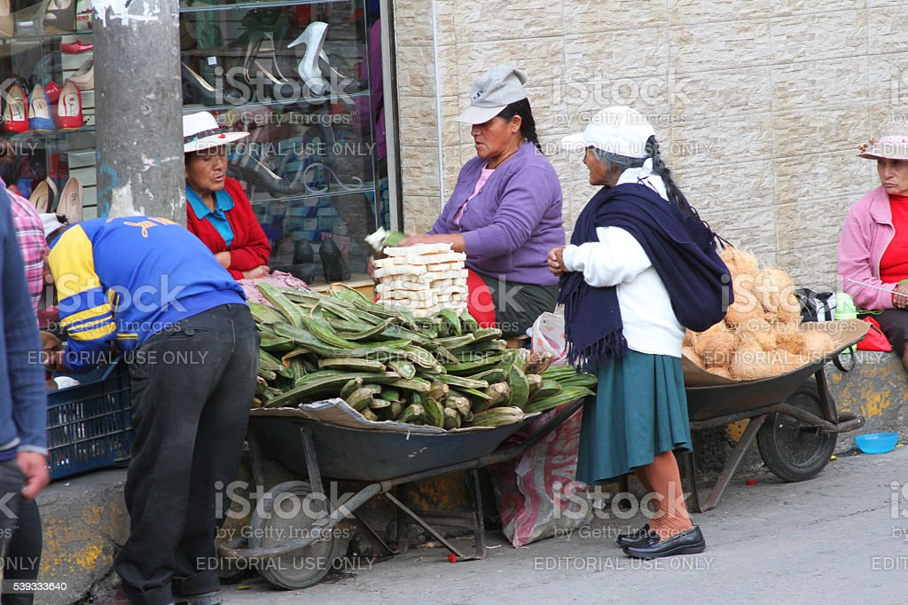 Women Sell Pakay Pods and Coconuts in Peru stock photo