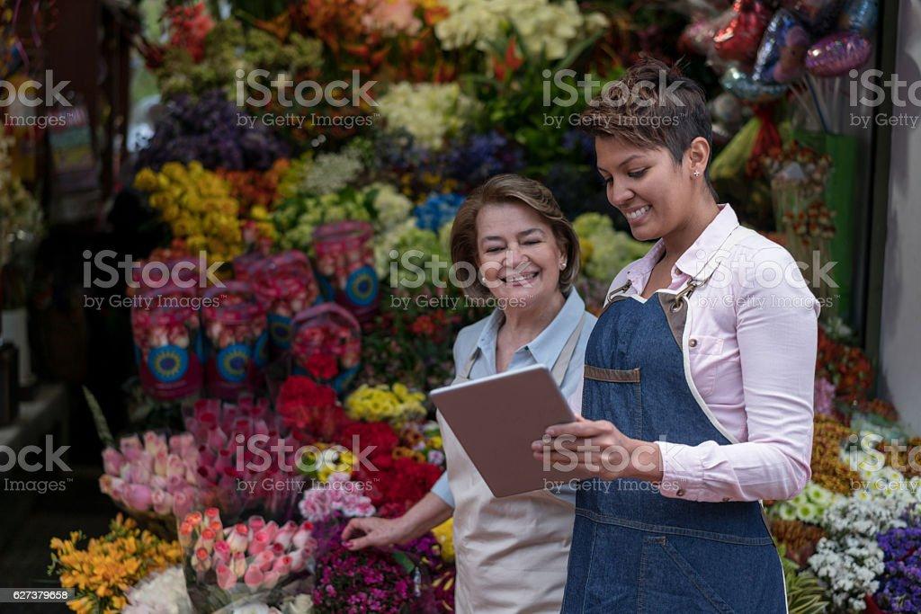 Women selling flowers online stock photo