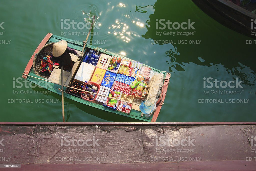 Women selling on the boat royalty-free stock photo