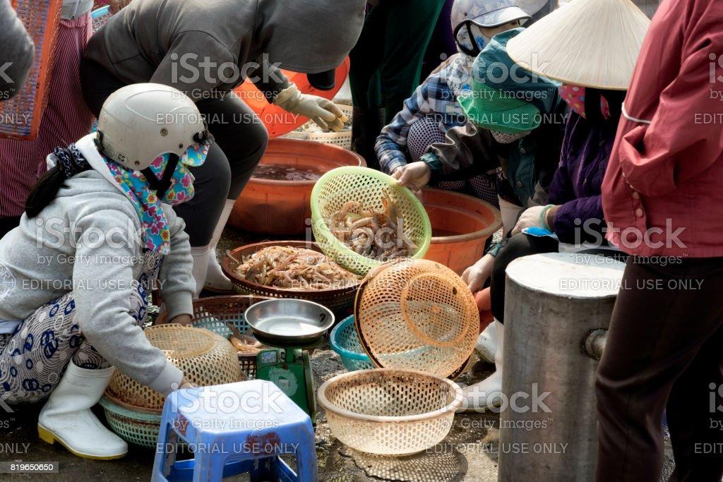 Women selling shrimps at the outskirts of Da Nang, Vietnam stock photo
