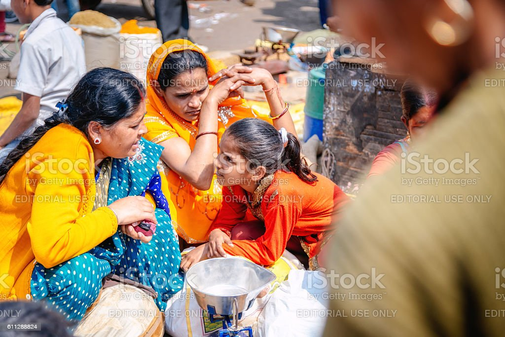 Women selling spices on markets in Delhi, India stock photo