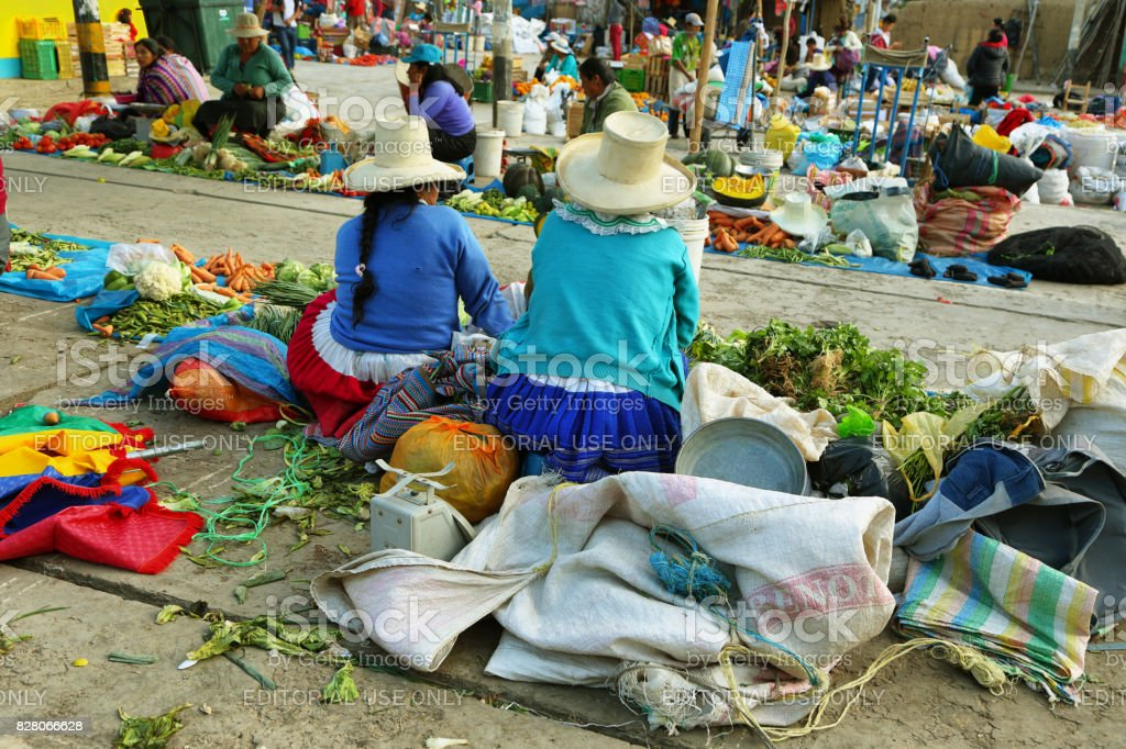 Women selling vegetables in a stall in Yungay, Peru stock photo