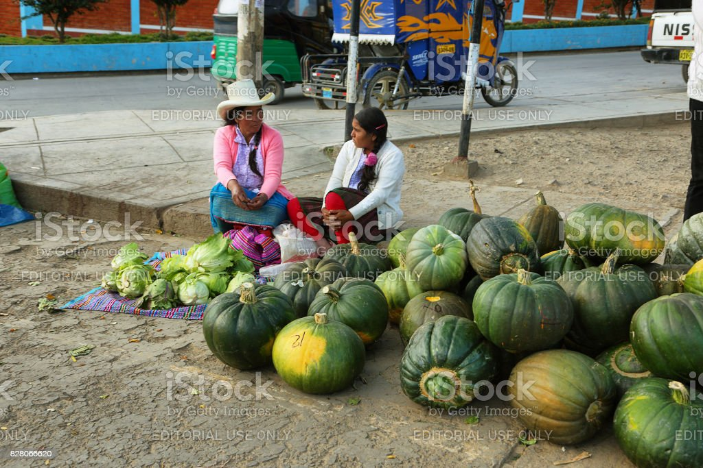 Women selling watermelons in a stall in Yungay, Peru stock photo