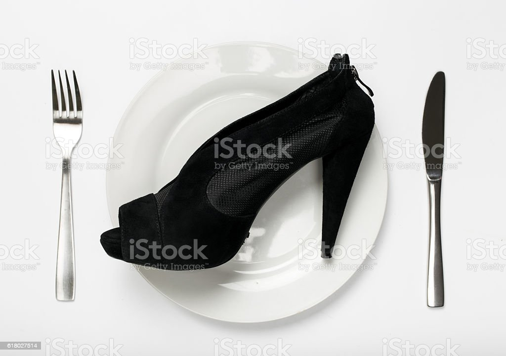 Women shoes on plate on a white background stock photo