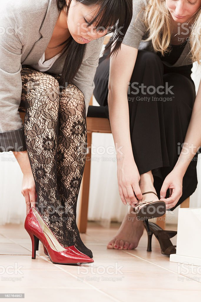 Women Shoes Shopping in Retail Fashion Store royalty-free stock photo