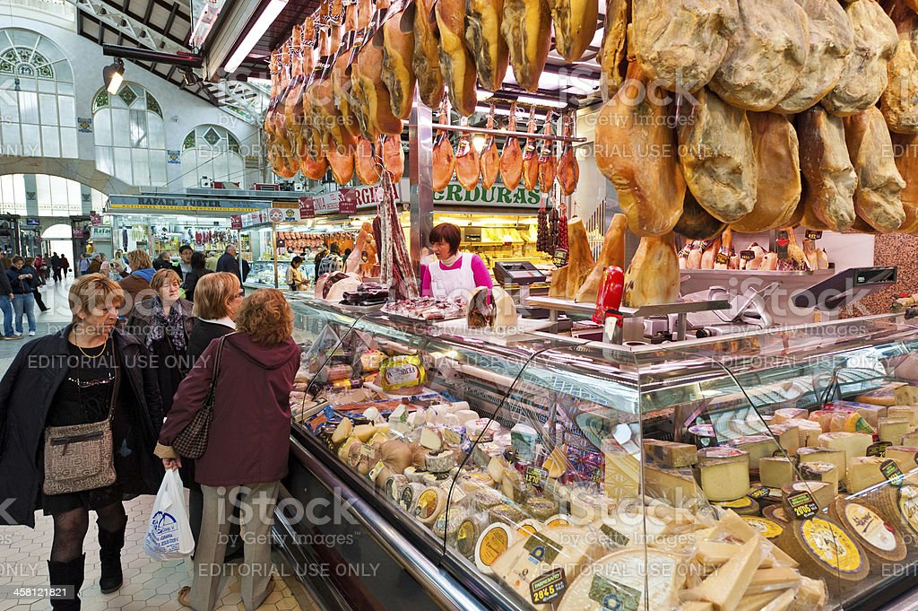 Women shopping at delicatessen market stall royalty-free stock photo