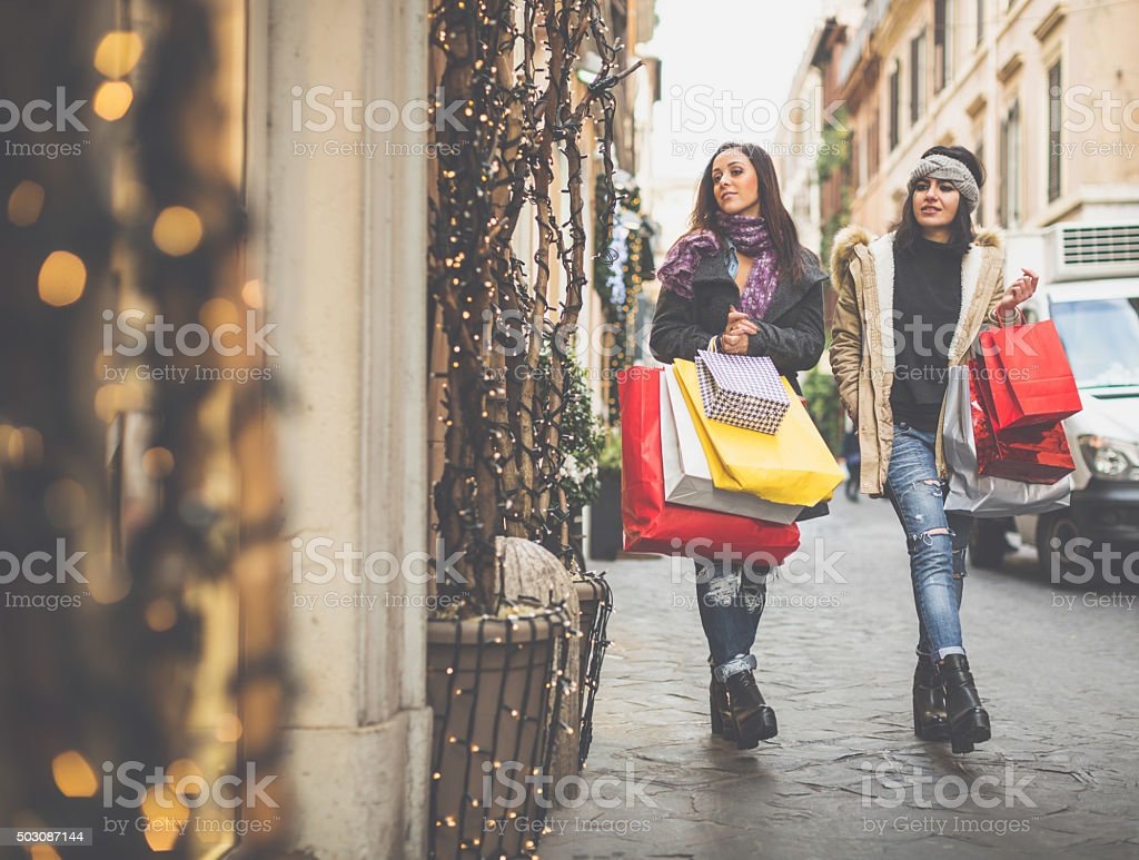 Women shopping during sales in Rome, Italy stock photo