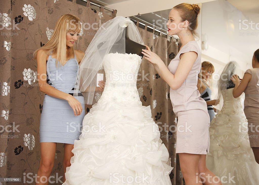 Women Shopping For Wedding Dress royalty-free stock photo