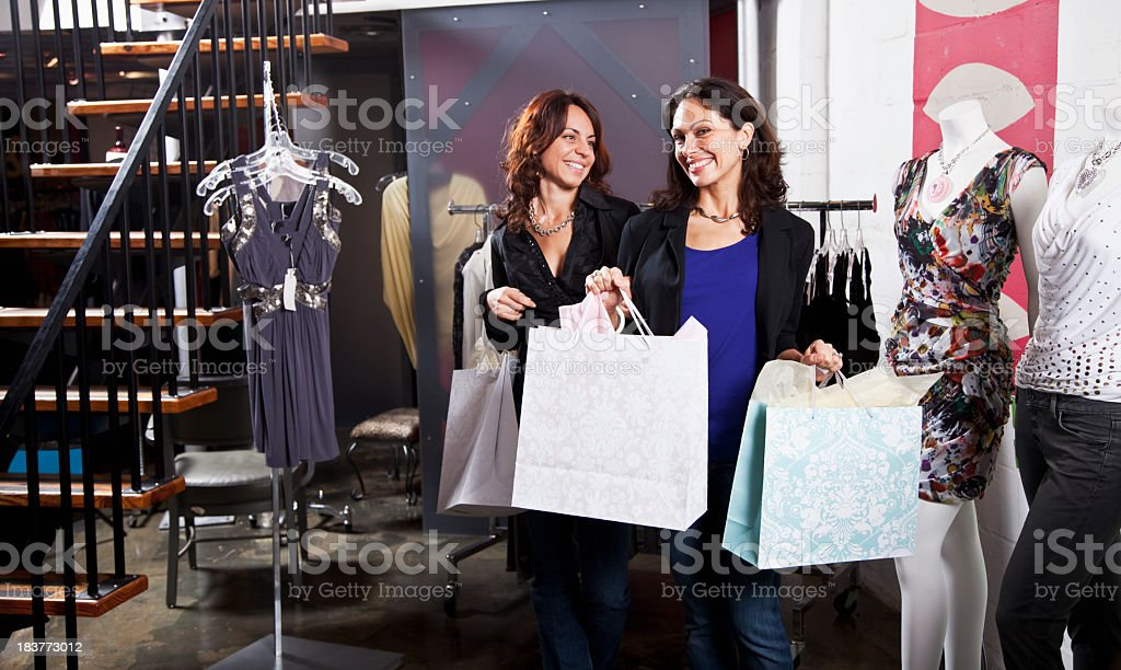 Women shopping in clothing boutique royalty-free stock photo