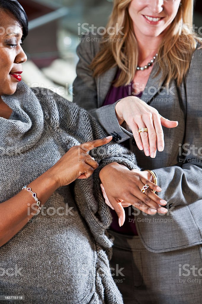 Women shopping in jewelry store royalty-free stock photo