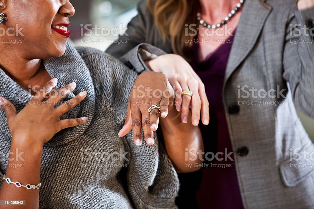Women shopping in jewelry store stock photo
