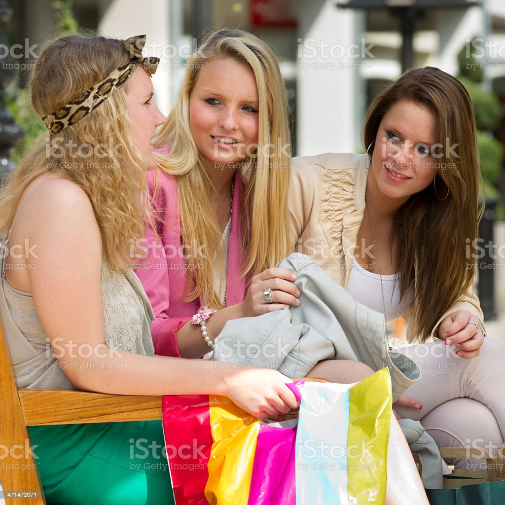 Women shopping, looking at new clothes stock photo