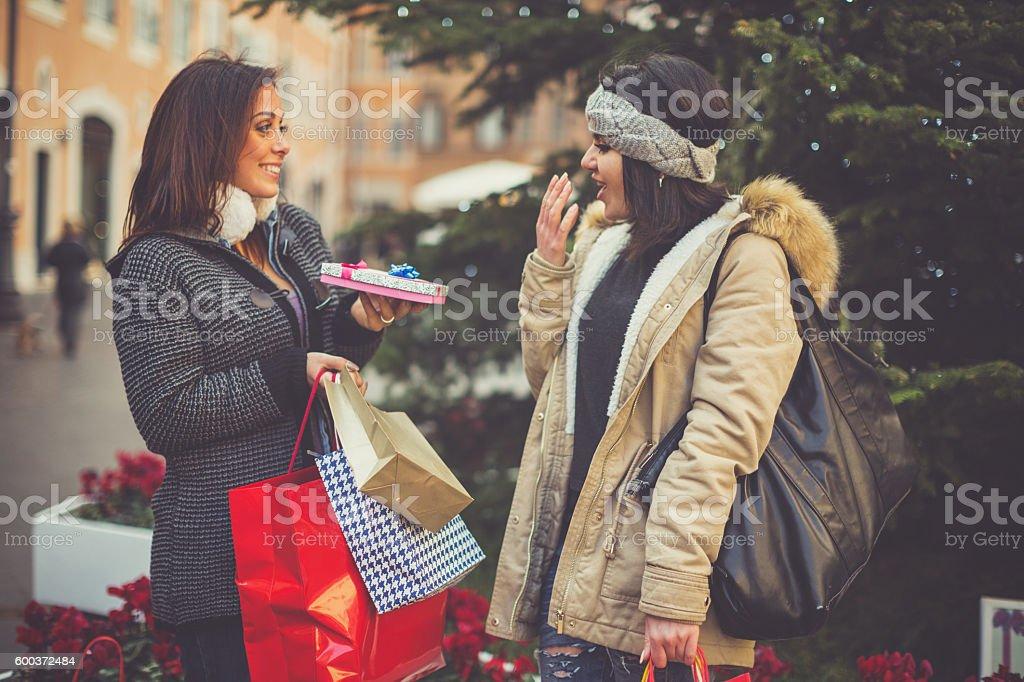 Women shopping: offering a little present stock photo