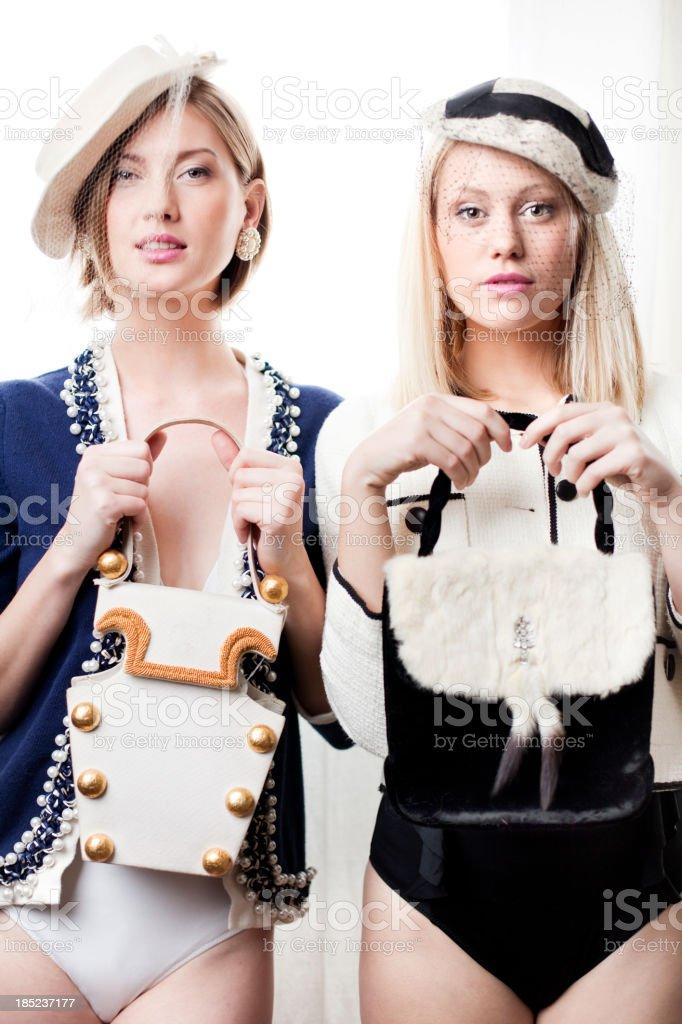 Women showing purses royalty-free stock photo