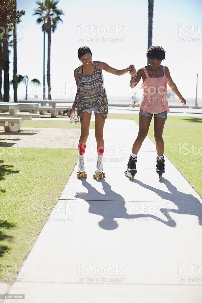 Women skating together outdoors royalty-free stock photo