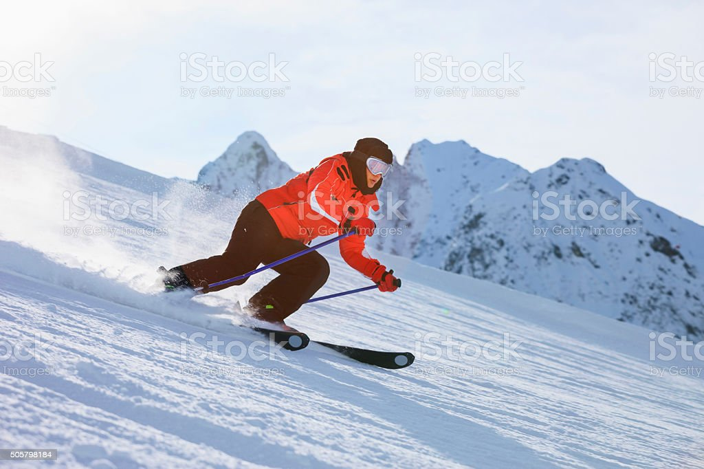 Women snow skier skiing on sunny ski resorts stock photo