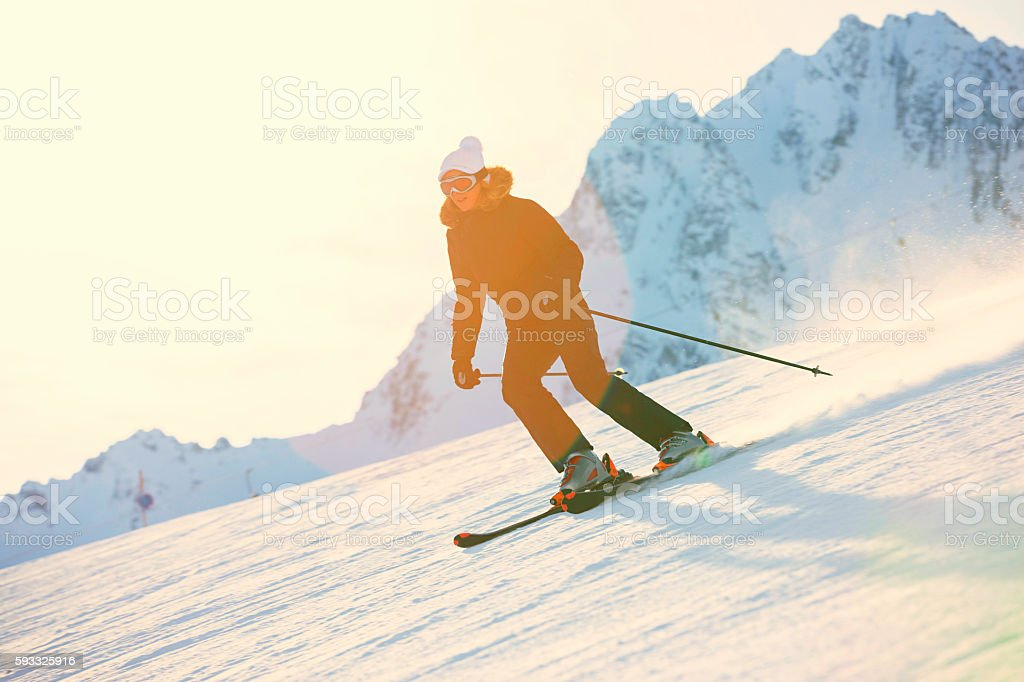 Women snow skier skiing on sunny ski resorts stock photo