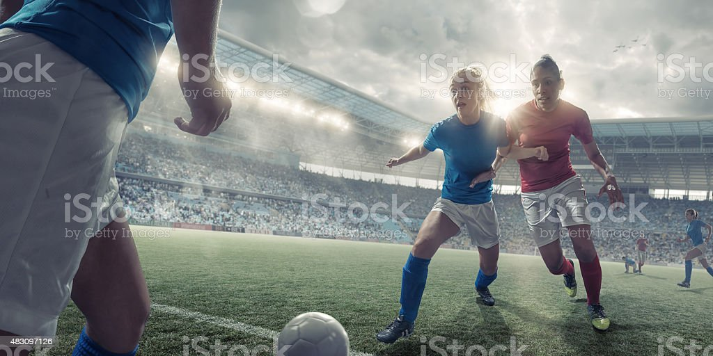 Women Soccer Players in Mid Match Action stock photo