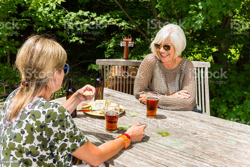Women socializing and drinking craft beer stock photo
