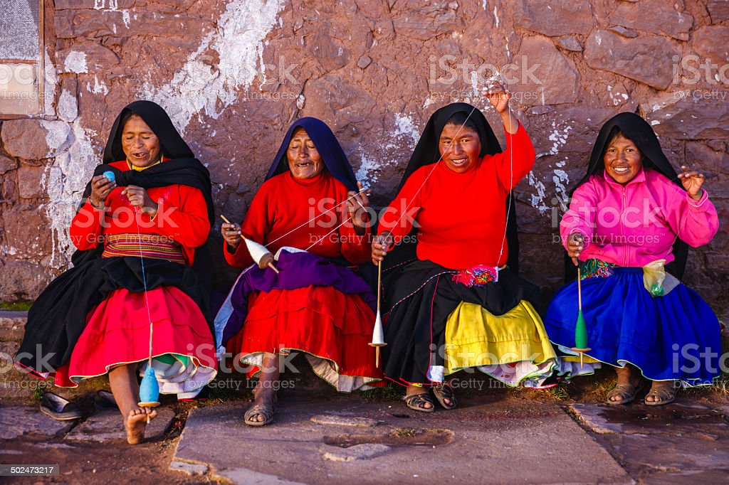 Women spinning wool on Taquile Island, Lake Titicaca, Peru stock photo