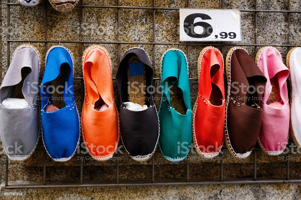 Women sport shoes on display at street market stock photo
