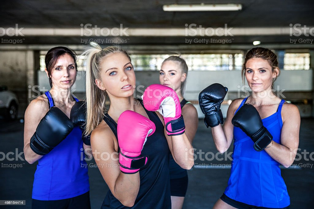 Group of women sport team boxing outdoor in a parking in Australia.