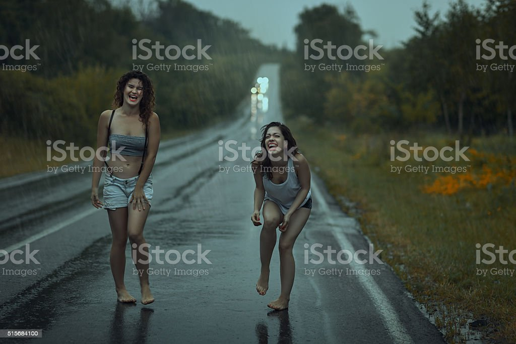 Women squirmy on the road. stock photo