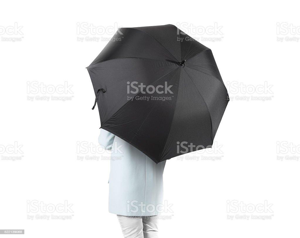 Women stand backwards with black blank umbrella opened mockup isolated stock photo