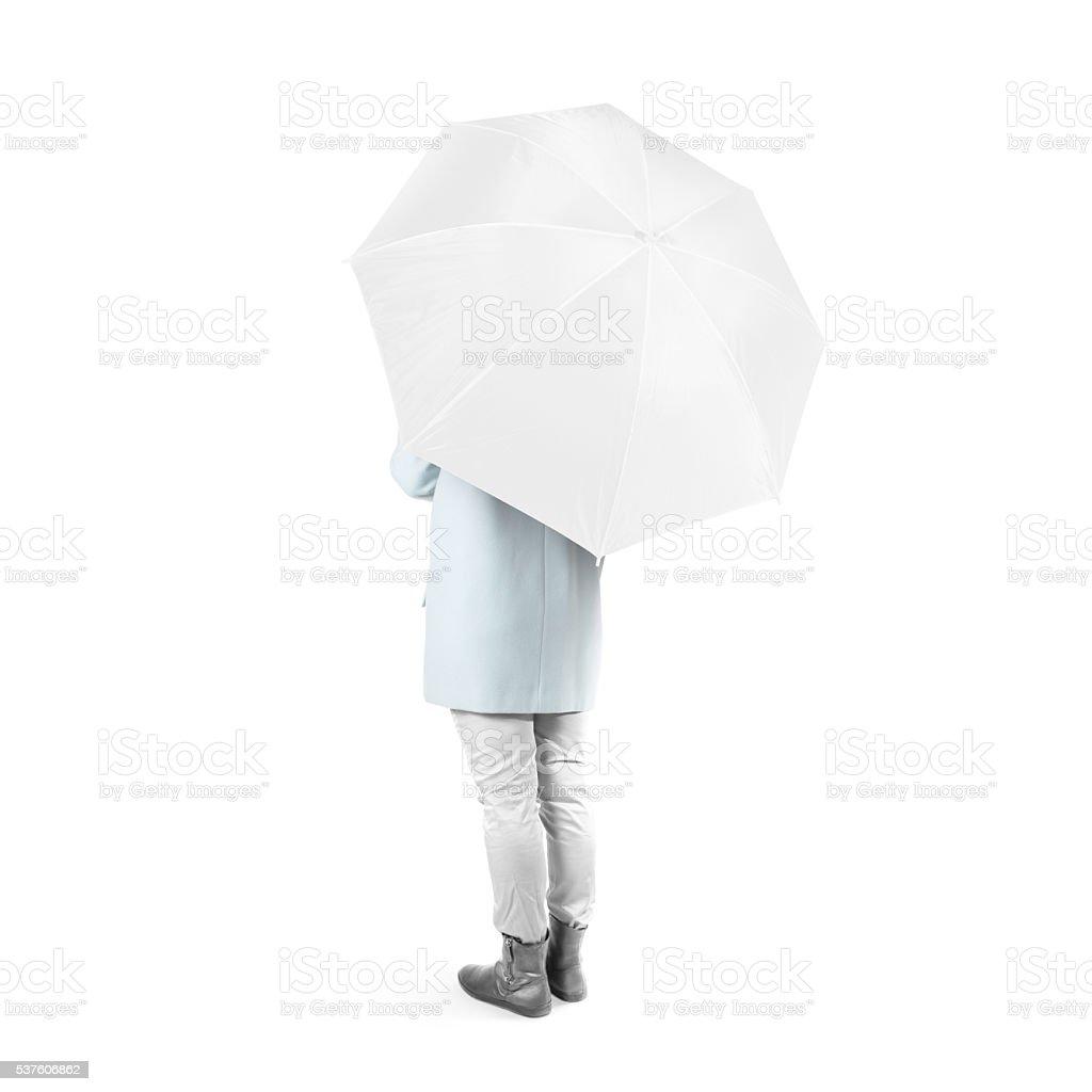 Women stand backwards with white blank umbrella opened mockup isolated stock photo