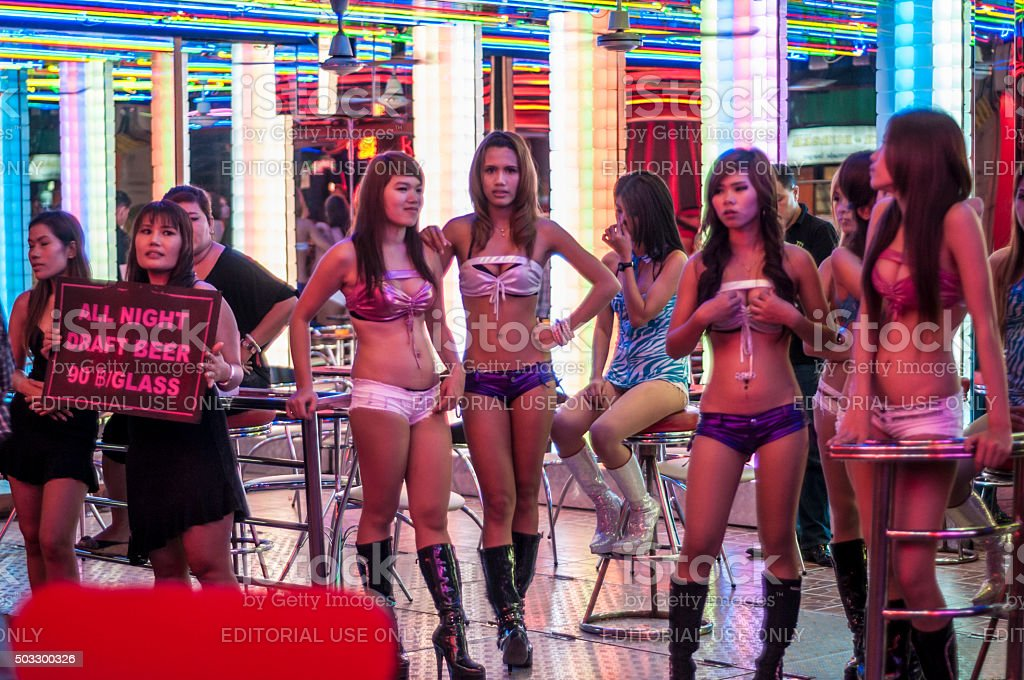 Women Stand Outside A Go-Go Bar In Soi Cowboy, Bangkok stock photo
