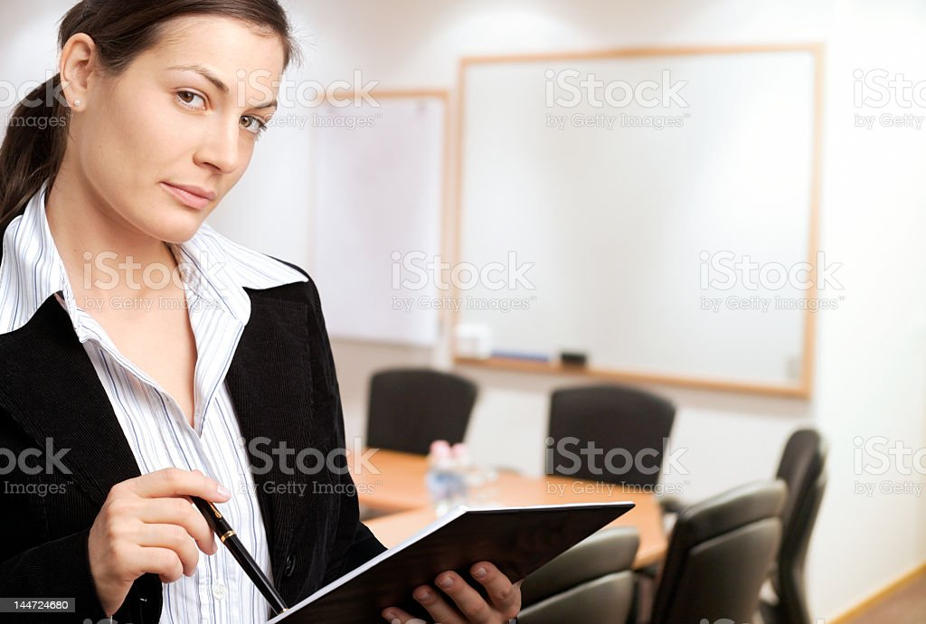 A women standing in front of a presentation room royalty-free stock photo