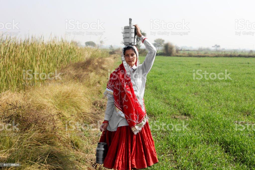 Women standing in the field portrait stock photo
