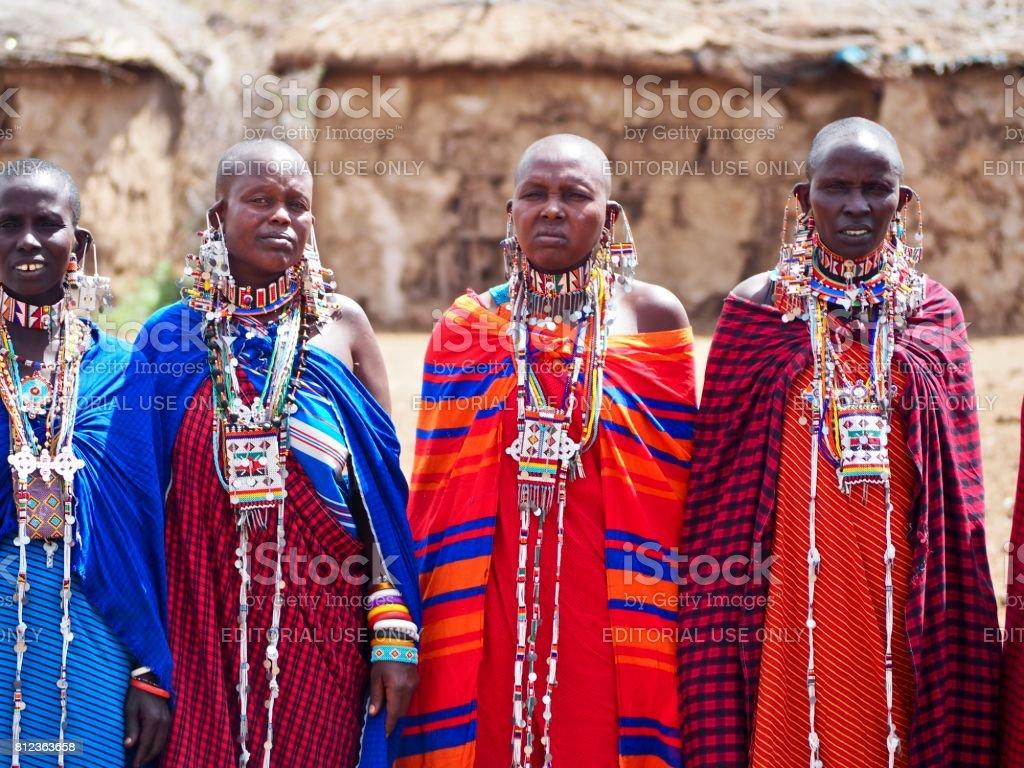 Women standing in traditional dress near Amboseli, Kenya stock photo